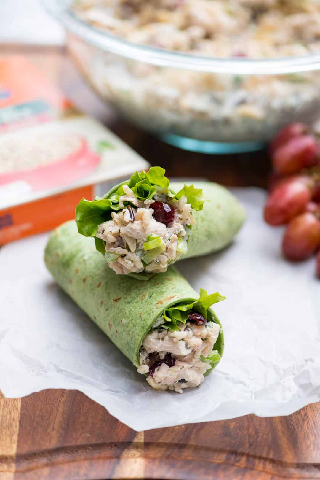 A Long Grain and Wild Rice Chicken Salad wrap cut in half and stacked.