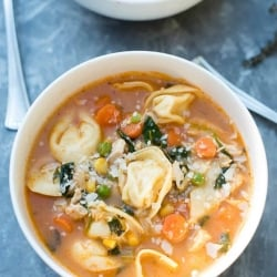 A bowl of Chicken Vegetable Tortellini Soup shot from over the top.