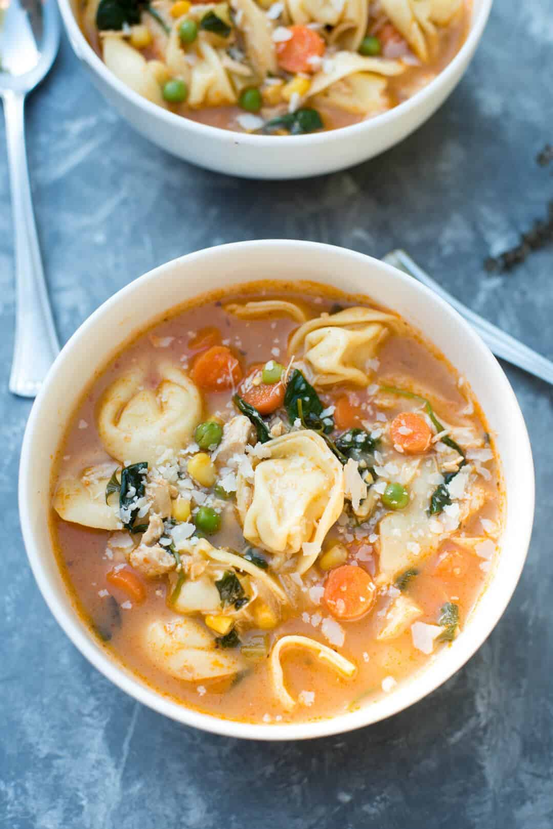 This Chicken Vegetable Tortellini Soup is made easy with a rotisserie chicken and store-bought cheese tortellini. A wholesome, comforting 30-minute meal!