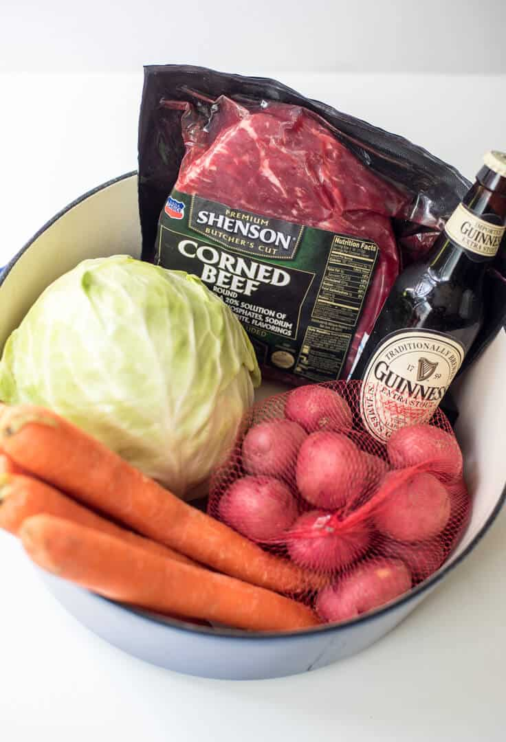 Guinness and beef broth cook down into a rich cooking liquid for corned beef, cabbage, carrots, and potatoes. Guinness Corned Beef is a one-pot wonder!