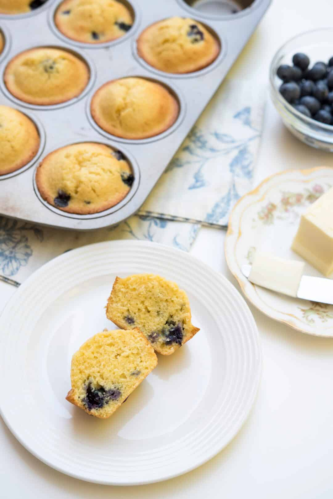 These Blueberry Cornmeal Muffins have a pretty yellow hue and a satisfying bite. Delicious served warm and slathered with butter!