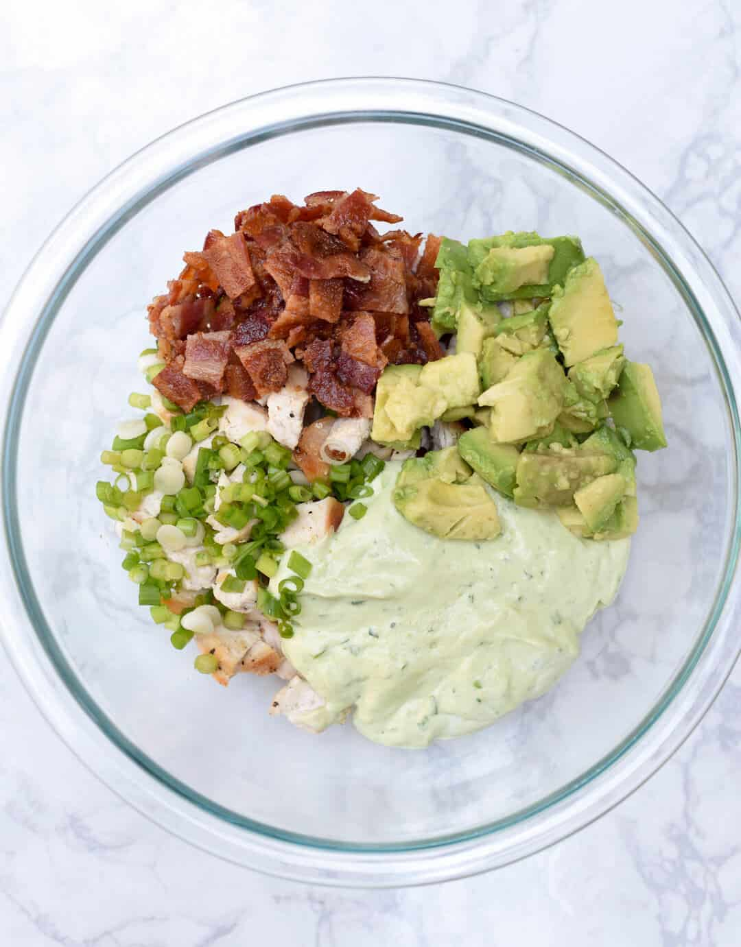 A fresh and creamy avocado based dressing combines with chicken and crisp bacon to create these Avocado Bacon Chicken Salad Sandwiches.
