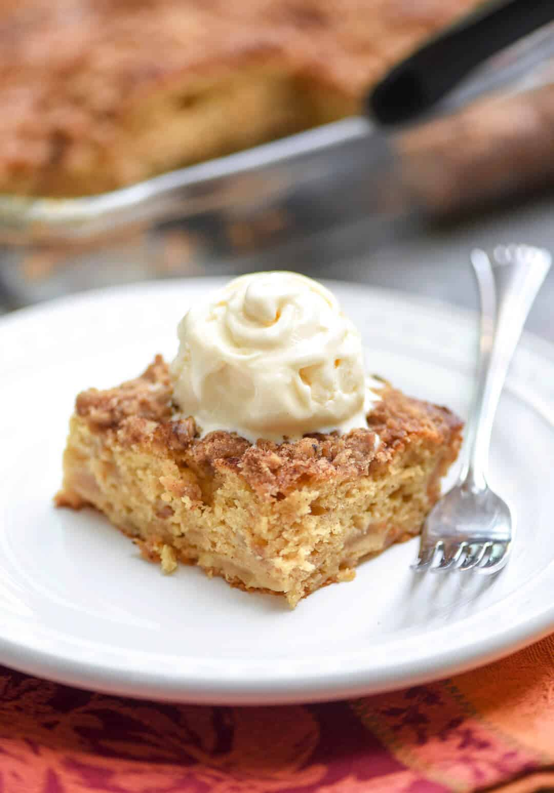 A super moist cake that is studded with apples and topped with a walnut streusel. Serve this Apple Crumble Cake with ice cream for dessert and eat the leftovers with breakfast the next morning!