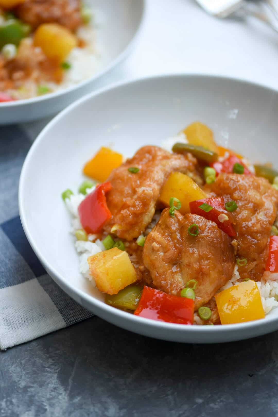 Slow Cooker Sweet and Sour Chicken with colorful bell peppers and pineapple chunks cooked in a sticky, sweet sauce. Fork tender and so flavorful!