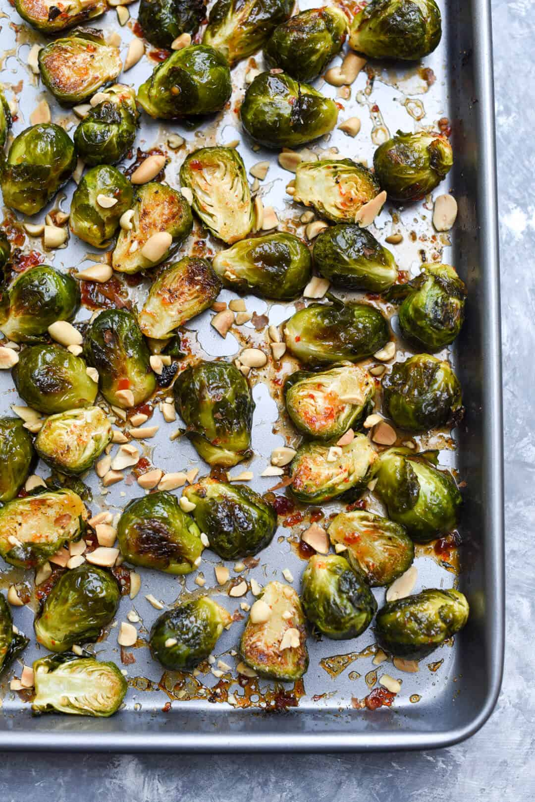 A baking sheet full of Chili Garlic Roasted Brussels Sprouts shot from over the top.