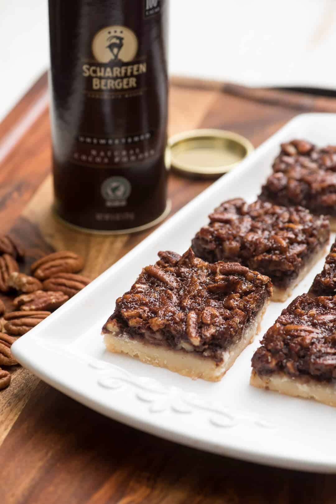 These Chocolate Bourbon Pecan Pie Bars have a shortbread crust topped with a gooey, chocolaty, bourbon-spiked pecan topping that is downright heavenly.