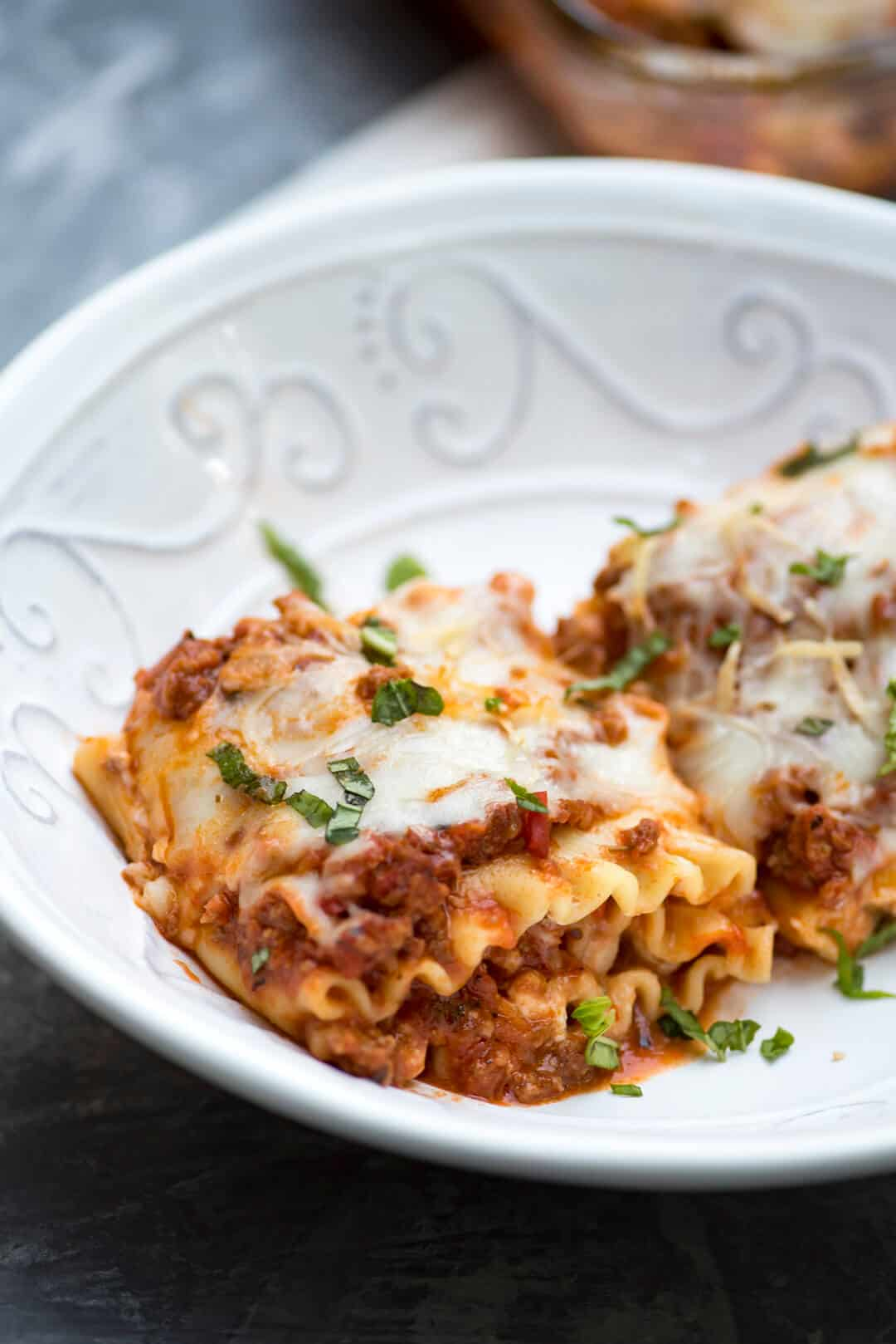 These Meaty Lasagna Roll-Ups are stuffed with a creamy ricotta mixture and a deliciously easy homemade meat sauce. A great make-ahead and freeze dish!