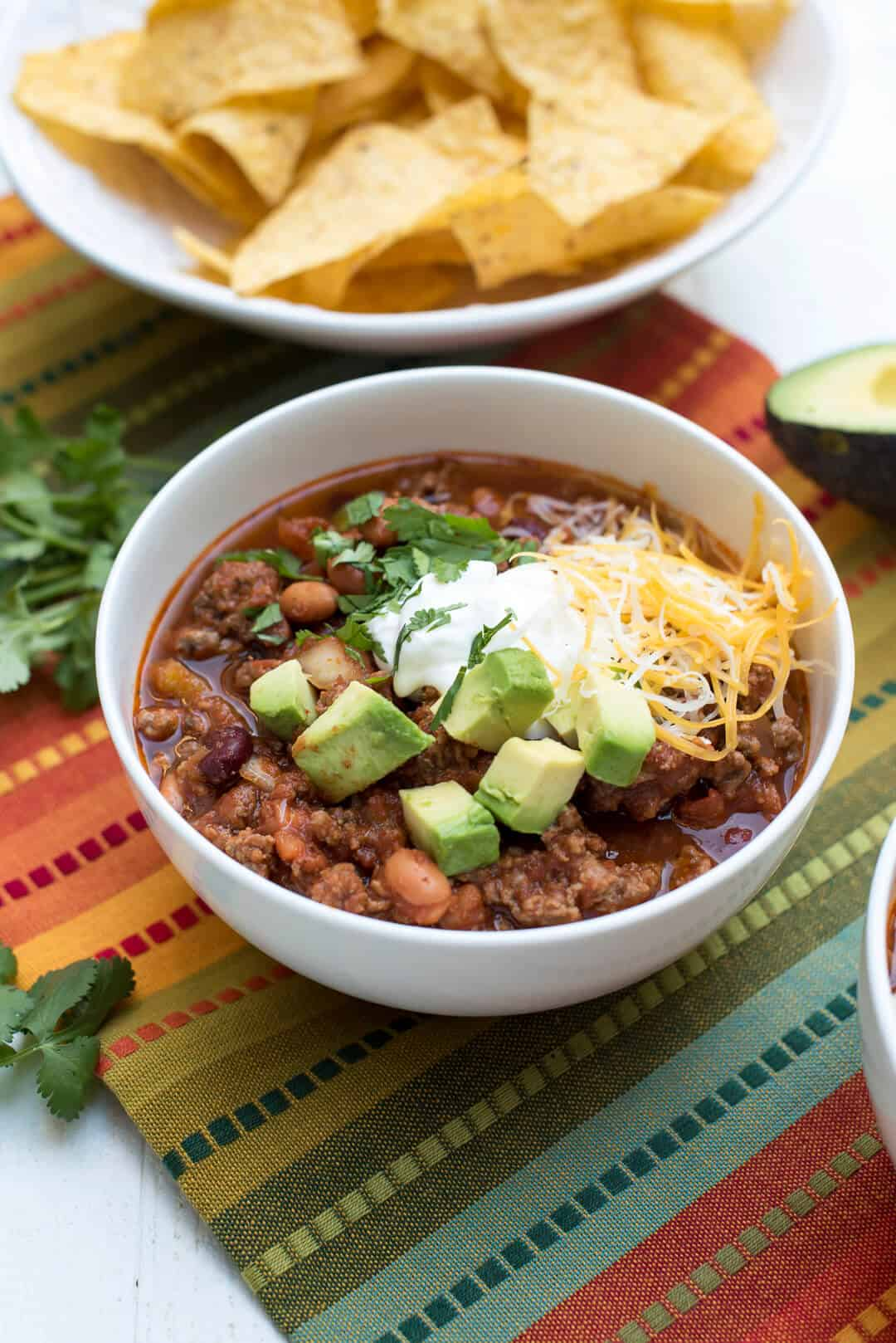 With just 15 minutes of prep time you'll have this beefy Slow Cooker Salsa Chili simmering away for a fun game day meal or no-fuss dinner on a busy day.