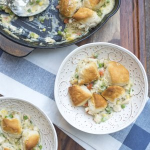 A bowl of Chicken Pot Pie topped with biscuits.
