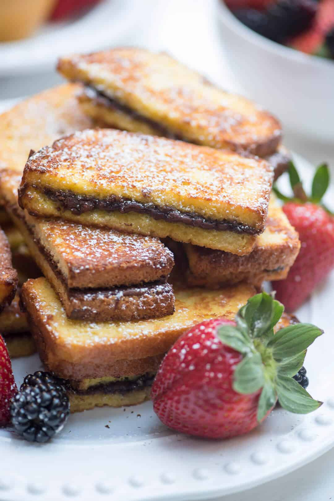 A serving of nutella stuffed french toast sticks.