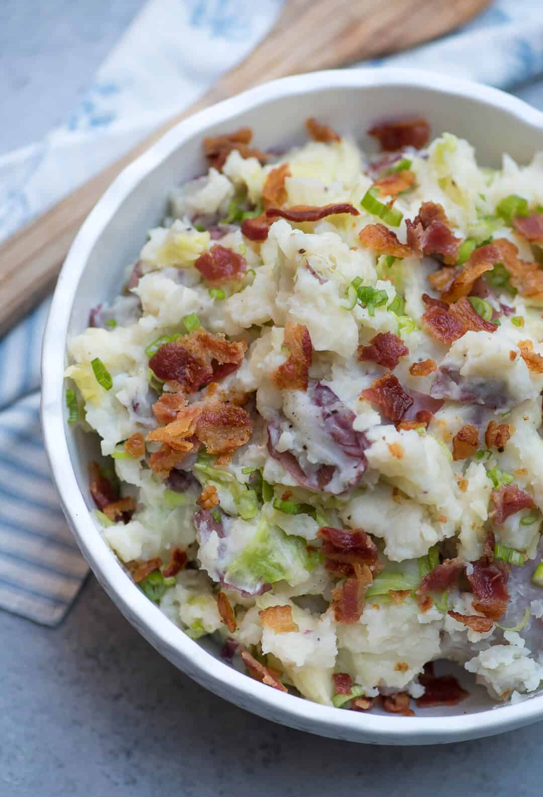 Close up of Irish Colcannon Potatoes in a white bowl