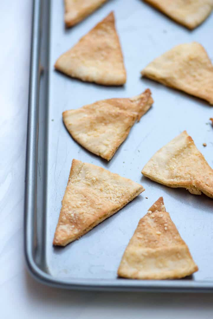 These homemade Parmesan Garlic Pita Chips are delicious served warm from the oven with hummus or a variety of other party dips. So much better than the store bought variety!