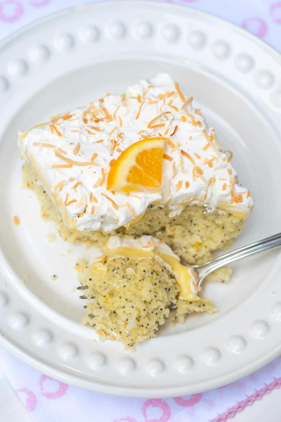 Lemon Coconut Poppy Seed Cake is a light, delicious choice that is perfect for any spring or summer gathering. This easy cake mix recipe is a fabulous, no-fuss dessert option.