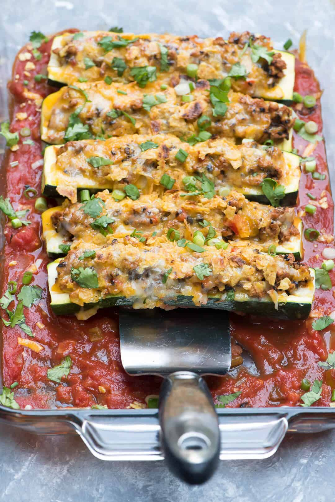 These Taco Stuffed Zucchini Boats are one of the most delicious things you can do with your summer zucchini. A wholesome, family-friendly dinner idea.