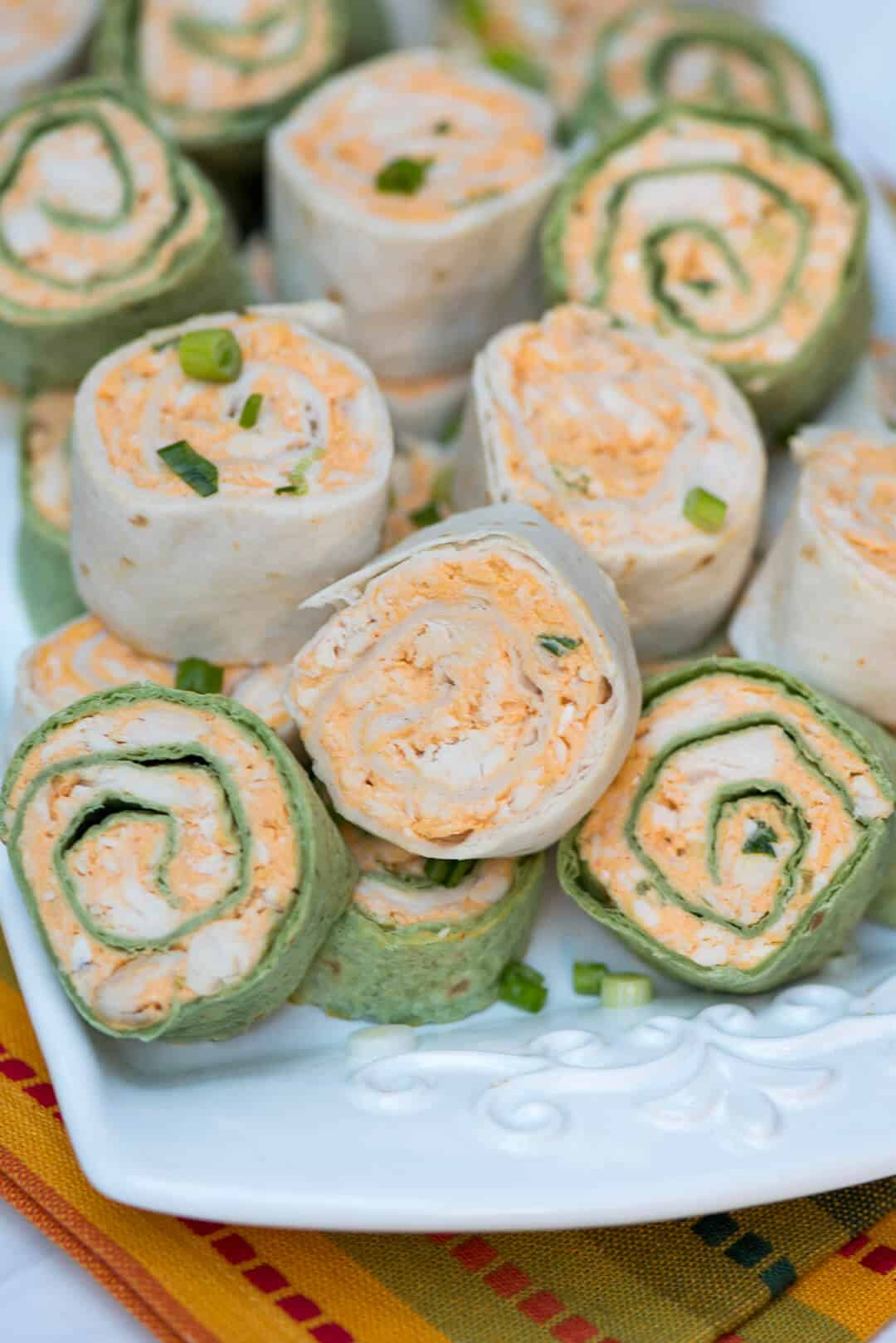 The totally irresistible flavor of Buffalo chicken wings all rolled up into a portable party snack. These Buffalo Chicken Tortilla Pinwheels are guaranteed to be a hit at your next gathering!