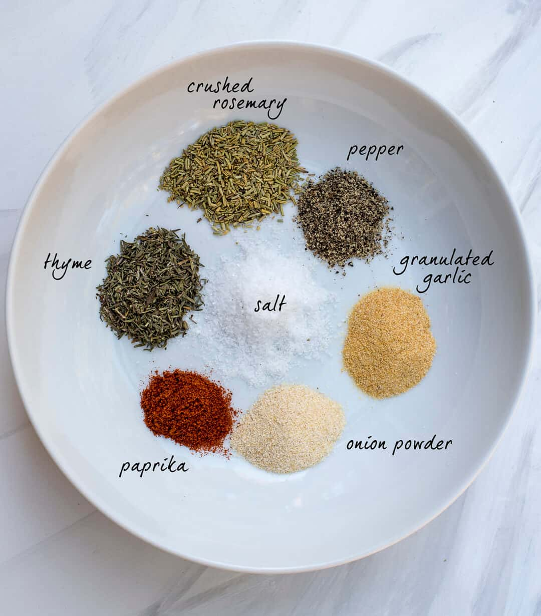 Instant Pot Pot Roast Rub - an assortment of dried herbs on a white dish