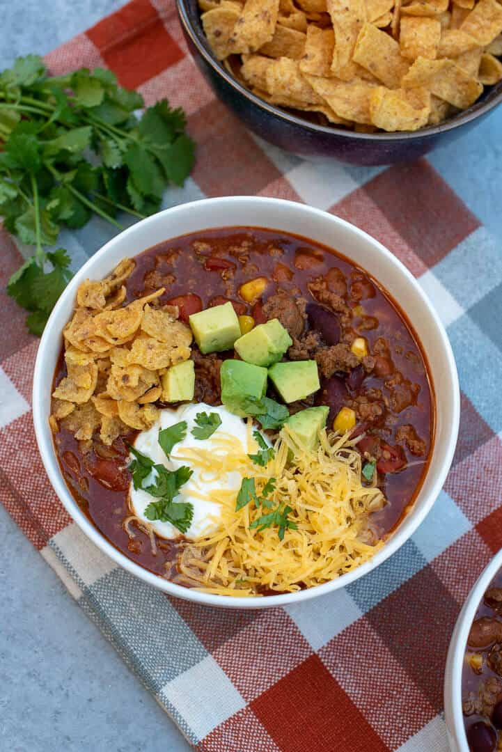 This flavor-packed Beef and Bean Taco Chili is loaded with ground beef, diced tomatoes, two kinds of chili beans, and corn. A hearty, super easy meal!