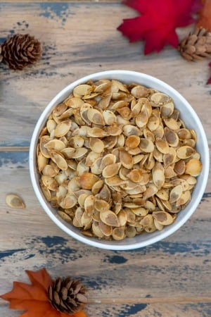 A bowl of roasted acorn squash seeds.