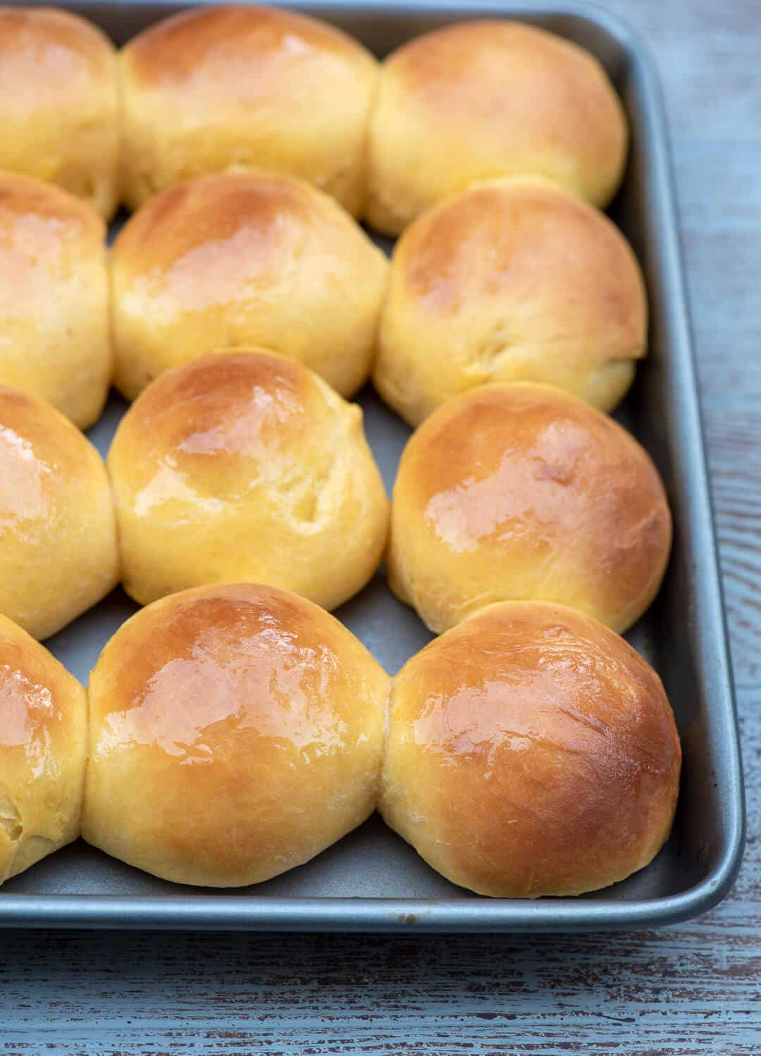 Sweet Potato Rolls on a sheet pan fresh from the oven.