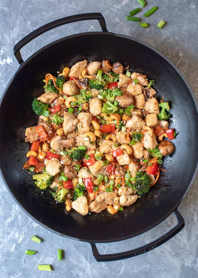 A wok shot from over the top filled with Cashew Chicken.