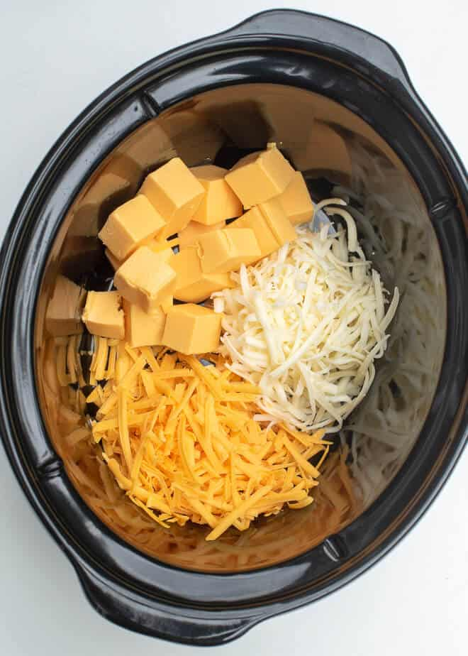 Velveeta, sharp cheddar and Monterey Jack in a slow cooker - how to make Slow Cooker Green Chile Chicken Queso
