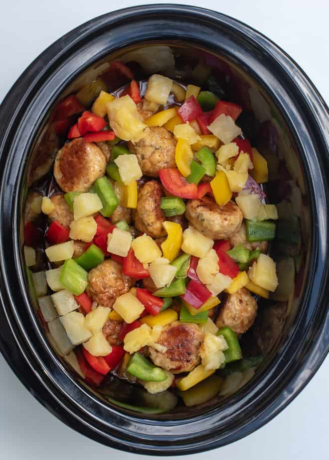 Slow Cooker Sweet and Sour Chicken Meatballs - combined with the sauce, bell peppers, and pineapple in the slow cooker