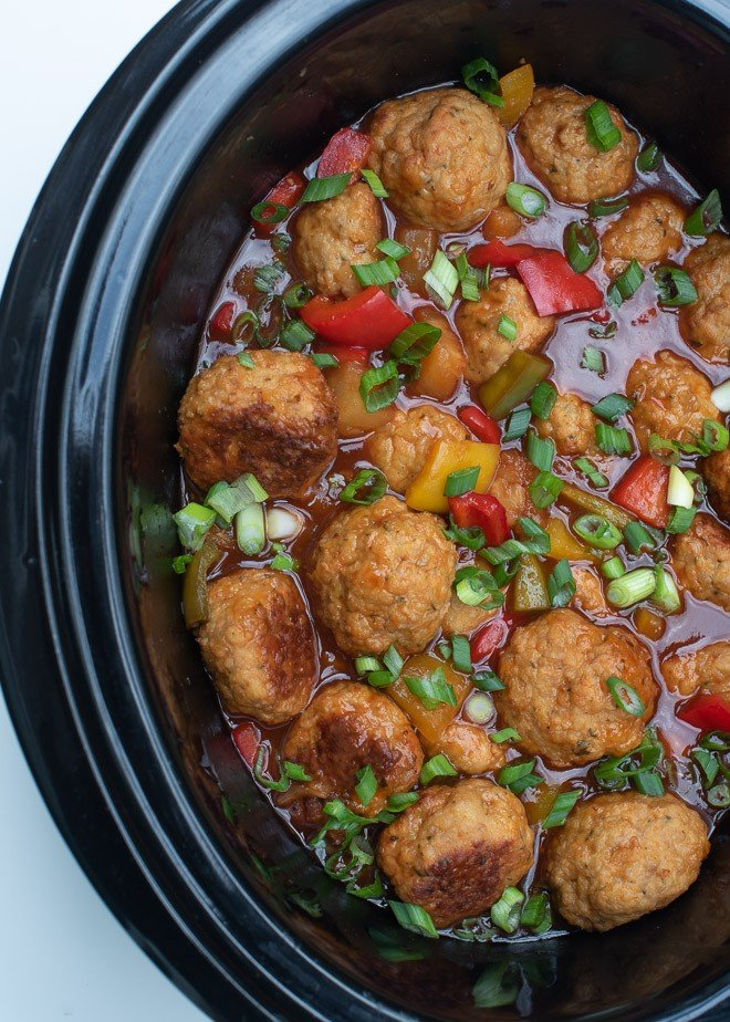 Serve these Slow Cooker Sweet and Sour Chicken Meatballs over rice for a super family-friendly dinner choice or straight out of the slow cooker at your next gathering.