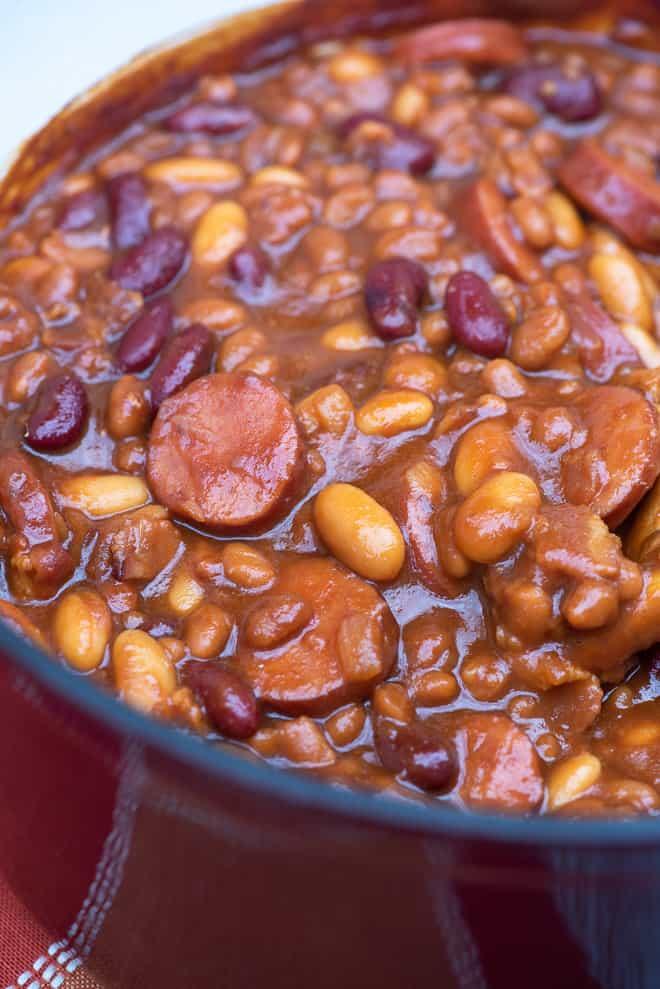 A close up shot of kielbasa (polish sausage) and beans.