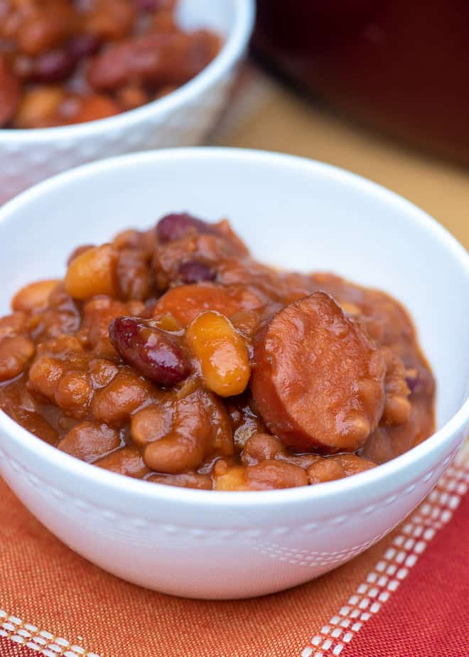 A single serving of Kielbasa Baked Beans in a small white bowl.