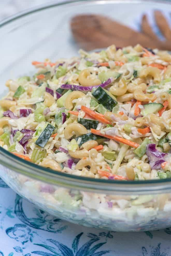 Macaroni Coleslaw in a clear glass serving bowl.