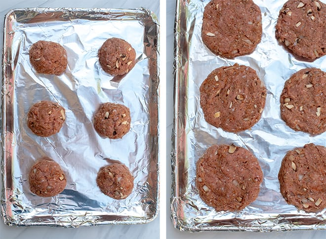 The turkey burger patties are assembled on a foil-lined baking sheet.