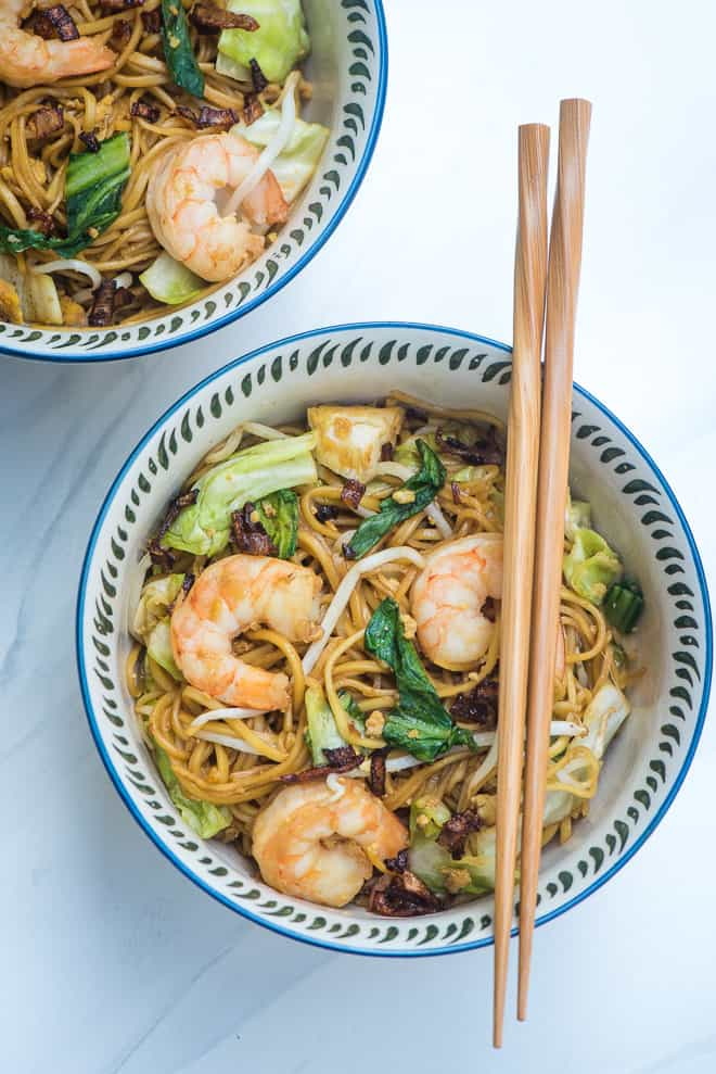 Stir Fried Noodles with Shrimp recipe (Easy Mie Goreng) in a patterned serving bowl with chop sticks laying over the top.