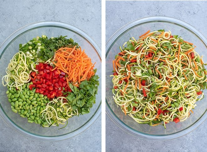 The ingredients for Asian Zucchini Noodle Salad combined in a clear glass bowl.