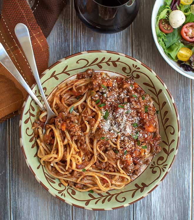 Big Batch Bolognese over pasta in a bowl.