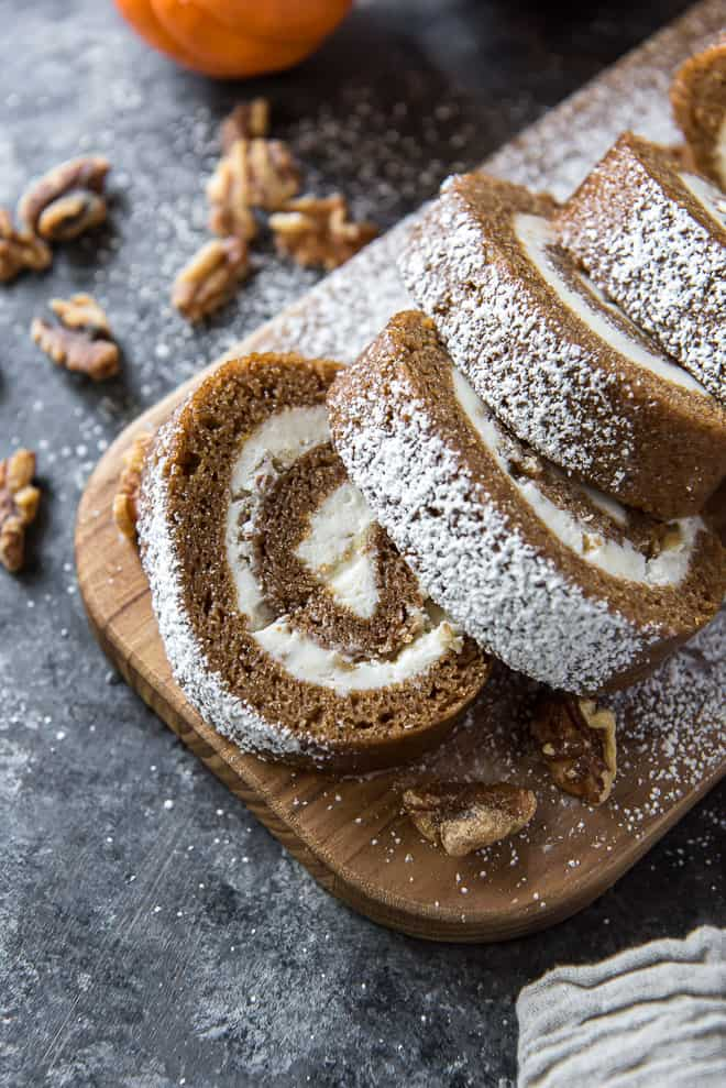 A close up of sliced Pumpkin Roll with Cream Cheese Walnut Filling.