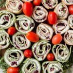 Colorful sliced pinwheels on a tray.