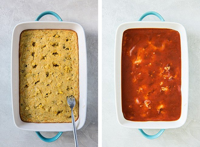 A layer of cornbread in a casserole dish is pierced with a fork and topped with enchilada sauce.