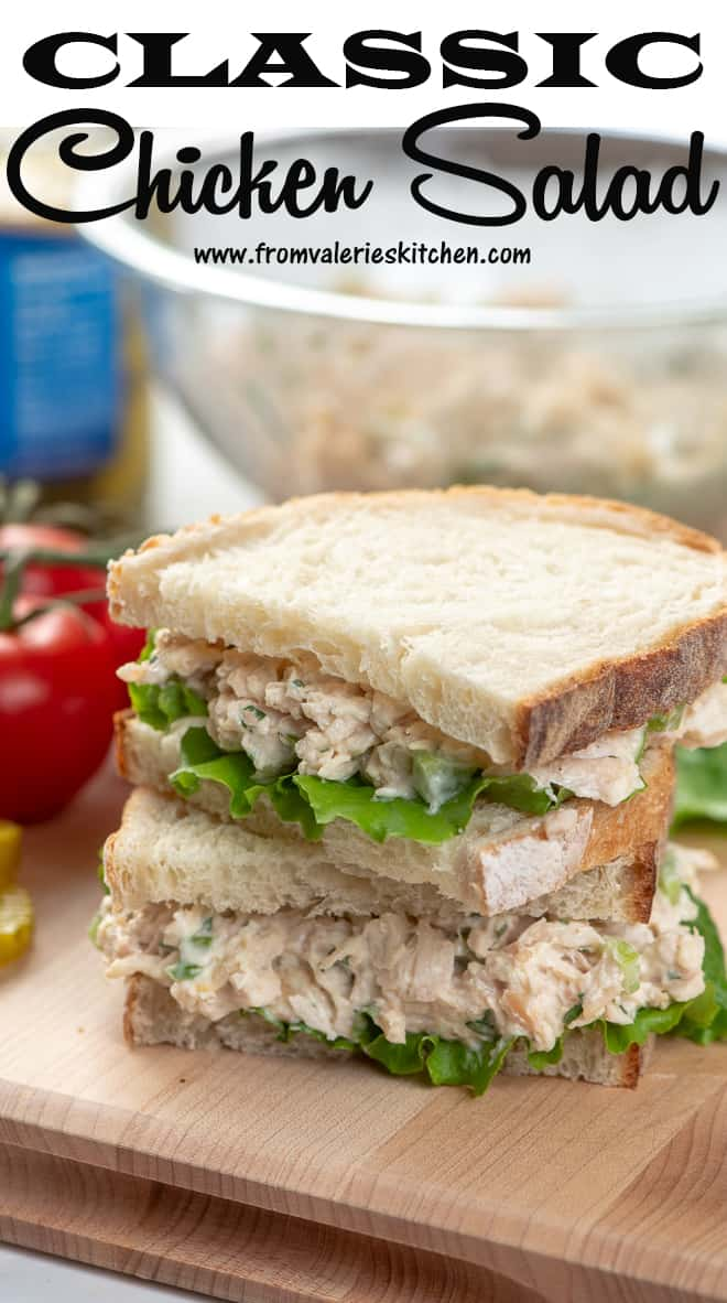 A Classic Chicken Salad Sandwich sliced in half and stacked on a cutting board with overlay text.