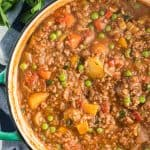A close up, over the top image of Hamburger Stew in a Dutch oven.