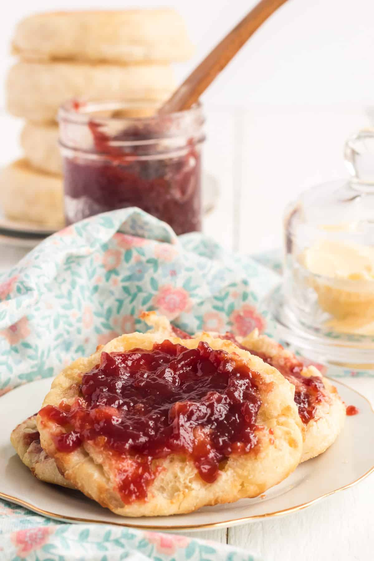 English muffins on a plate with jelly.
