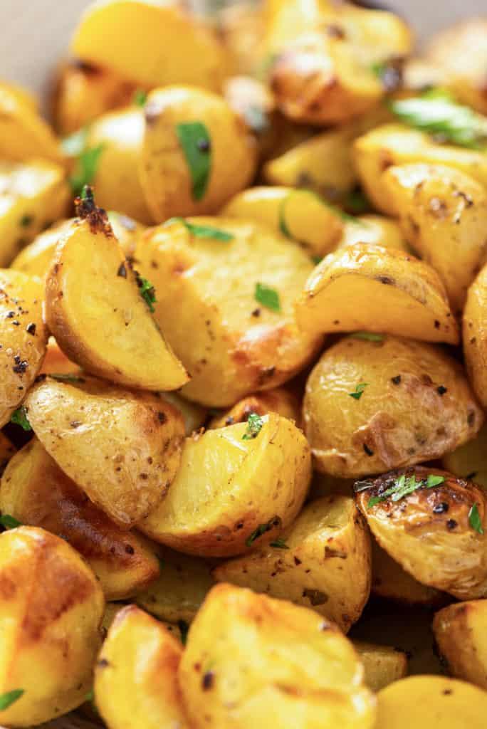 A closeup of a pile of Greek Potatoes.