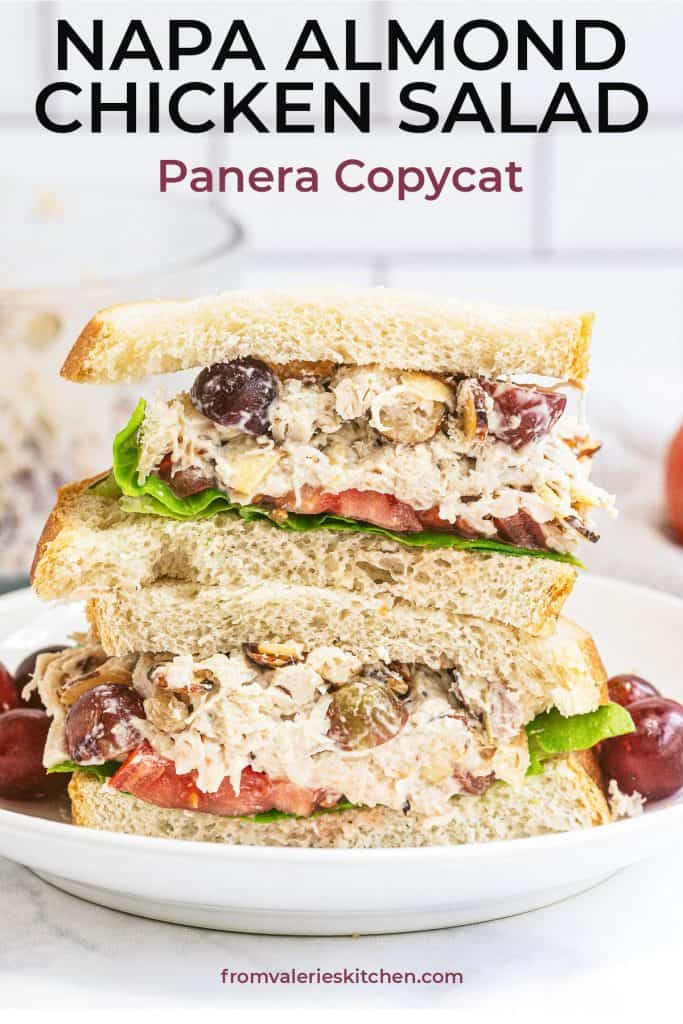 A Napa Almond Chicken Salad Sandwich sliced in half and stacked on a white plate with text overlay.