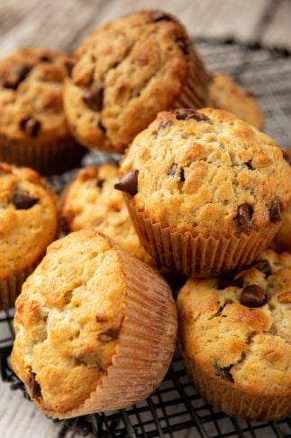A close up of a pile of muffins.