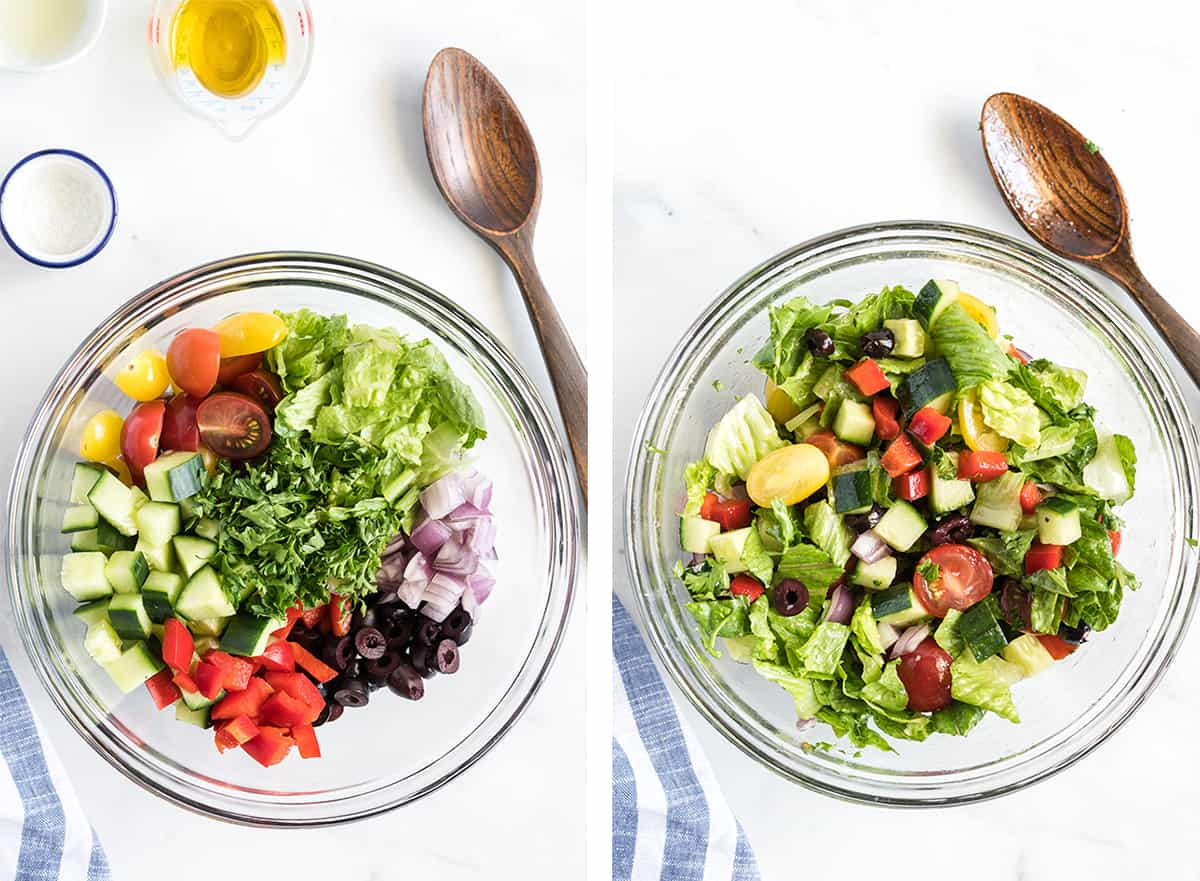 Tomatoes, cucumber, bell pepper, kalamata olives and lettuce are combined in a glass bowl.