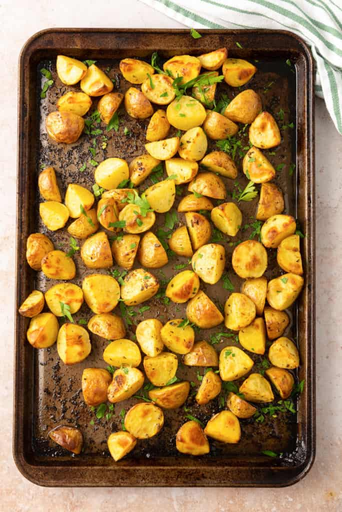 Lemon Roasted Greek Potatoes on a baking sheet shot from over the top.
