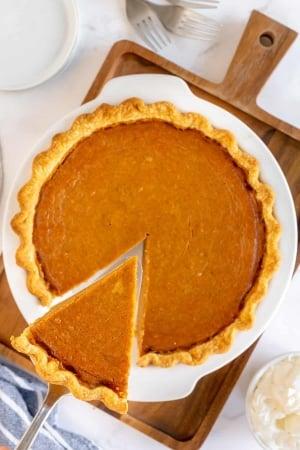 A spatula lifts a slice of pie.
