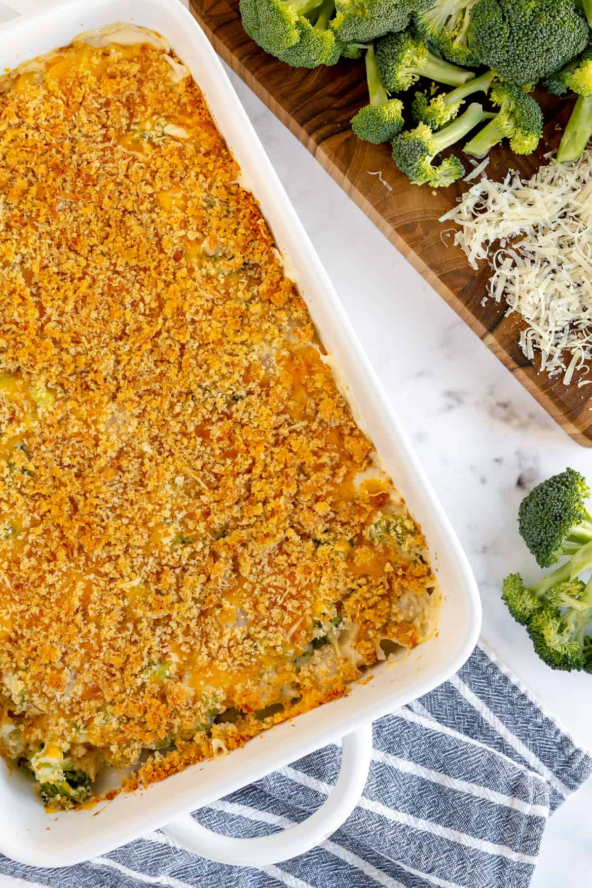 Broccoli Pearl Onion Casserole topped with browned bread crumbs shot from over the top.