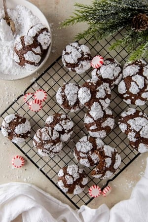 Chocolate Peppermint Crinkles on a wire rack with peppermint candies.
