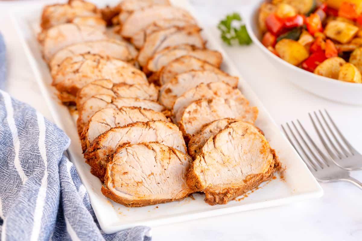 Sliced pork on a platter.
