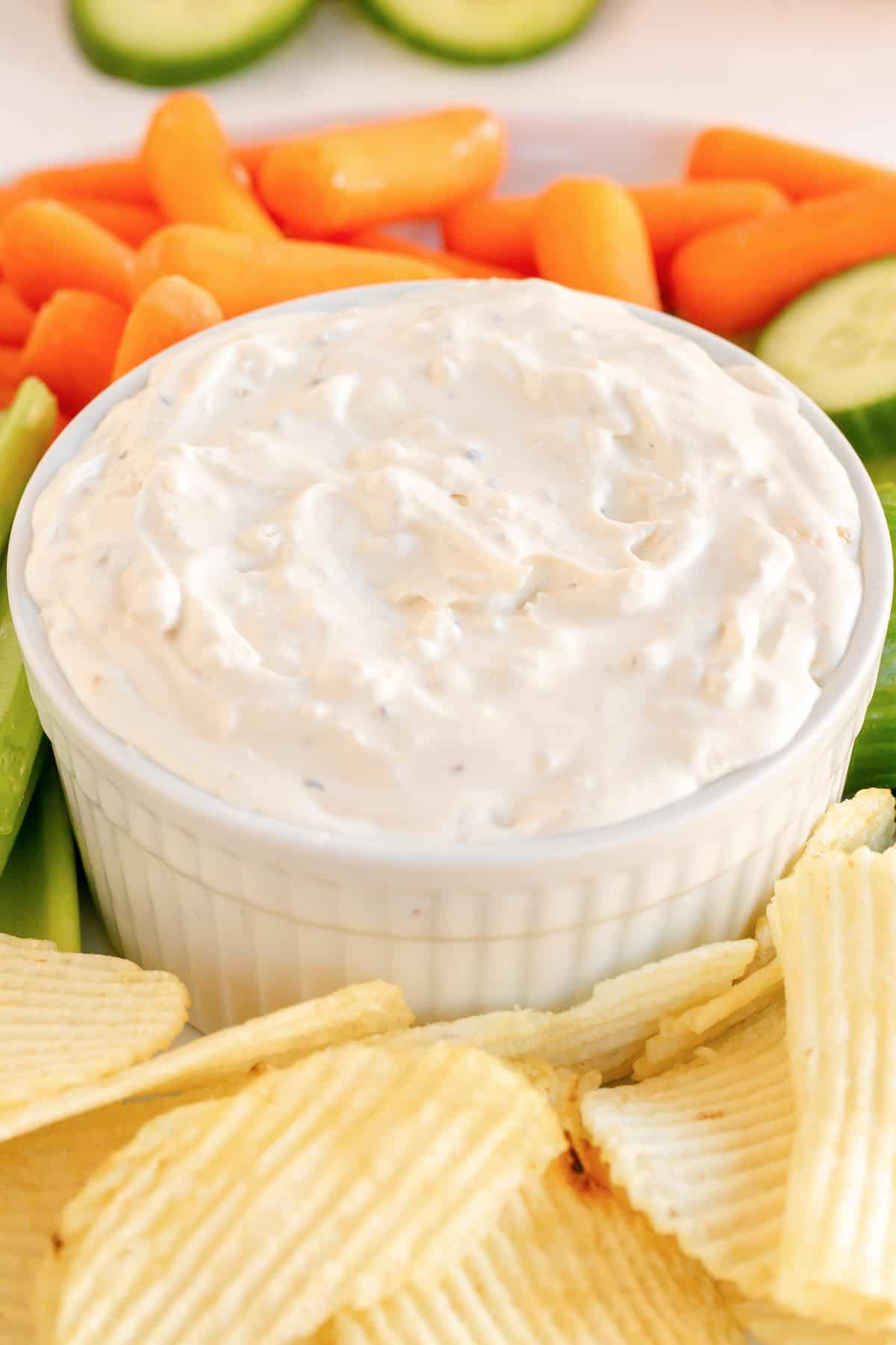 A close up of French Onion Dip in a small white dish.